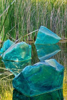 Chihuly Blue Polyvitro Glass Rocks in lagoon - Desert Botanical Garden by Al_HikesAZ, via Flickr