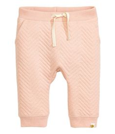 Powder pink. Soft sweatpants with an elasticized drawstring waistband, side pockets, and ribbed hems. Soft, brushed inside.