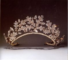 A tiara of oak leaves, acorns and hollow acorn cups designed in the manner of Ancient Greek jewellry, set with a profusion of brilliant-and rose-cut diamonds. Made by Garrard after the neo-classical fashion of the early 19th century for the 15th Duke of Norfolk to give to his bride, Gwendolen Constable Maxwell, on the occasion of their marriage in 1904.