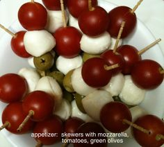 appetizer: skewers with mozzarella, tomatoes, green olives