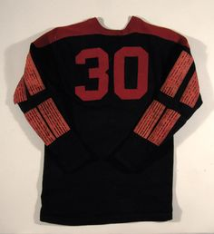 "Fine friction strip football jersey c.1920s-1930s. Woolen jersey with black body having applied ""30"" player number on back and a series of ""friction strips"" applied to front and sleeves. Uncommon friction surface features a 'beaded' patination. $750"