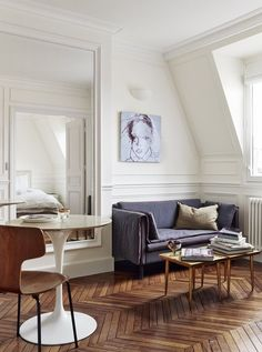 Stunning artwork and simplistic layout that heavily complements the herringbone wooden floors.