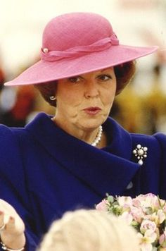 Queen Beatrix-- From the 1970s until 2003, Harry Scheltens designed most of Queen Beatrix's hats. From all accounts, Scheltens was a playful personality who took greater risks with Beatrix's hats as the years went on.