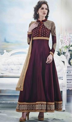 Stupefy everyone around wearing this eggplant shade chiffon and net Anarkali churidar suit. Beautified with butta, lace and resham work.  #AwesomeMagentaStandColleredAnarkaliDress