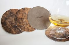 Modern Cowhide Coasters, set of 4, with extra protective leather backing on Etsy, masculine, rustic, wedding, groomsmen, barware, natural, leather