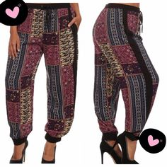 """CUTE MULTI COLOR JOGGERS! VERY FULL! WILL FIT LARGER SIZES TOO! Pretty ethnic, multi color print with black elastic waist, side accent strips and elastic ankles. Drawstring waist to make it as comfy as you wish! 100% soft rayon.♦️1X waist 35-45"""" hips 51"""" inseam 27.5""""♦️2X: waist 36-46"""" hips 54"""" inseam 28""""♦️3X: waist 38-48"""" hips 56"""" inseam 29.5""""   PLEASE DO NOT BUY THIS LISTING, I will personalize one for you. tla2 Pants Track Pants & Joggers"""
