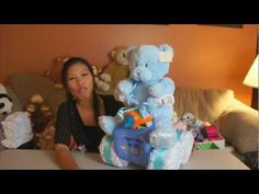 Just a quick video on how to make a simple Quad Runner Diaper Cake. Another fun gift you can make for a baby shower gift.      Quad Runner Diaper Cake - Nappy Cake - Baby Shower Gift - New Born - Party Favor