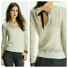 Free People Pointelle Embellished Tie Back Sweater BNWT Free People Tie Back Pointelle textured sweater WI/embellishment 3D seaming sz LARGE  Ivory color  THE price portion on tag was torn off at perforated edge (was given to me as a gift several yrs ago during my FP only phase.so not sure of exact msrp put in $99 will look up and revise appropriately  regardless .NEVER WORN TAG ATTACHED ...RECENTLY REDUCED THUS PRICE IS firm Free People Sweaters Crew & Scoop Necks