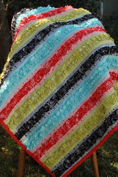 Strip quilt with ruffles!  For whoever next has a girl.