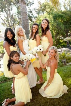 Yellow bridesmaids dresses for the spring. This would be so pretty with rose bouquets.