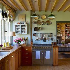 Farmhouse Kitchens With Undeniable Charm Counters Of Reclaimed Mahogany Top Pine Cabinetry In The Kitchen Writer Amanda Brooks Oxfordshire England