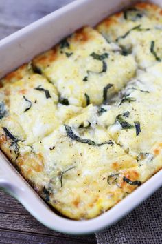 Spinach Artichoke Egg Casserole Recipe on twopeasandtheirpod.com This easy egg casserole is perfect for breakfast, brunch, or dinner.