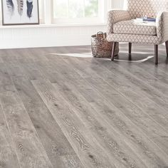 Liven up the look of any room in your home with the addition of this Home Decorators Collection EIR Randell Oak Thick Wide Length Laminate Flooring. Laminate Flooring Basement, Laminate Flooring On Walls, Home Depot Flooring, Installing Laminate Flooring, Wood Laminate, Hardwood Floors, Wooden Floor Tiles, Wooden Flooring, Houses