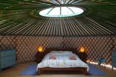 """Our beautiful, new family yurt provides a large open space for sleeping and chilling out. It features a double bed and double sofa sofa bed and comfortably accommodates two adults and two children or three adults. It is only available April through November. The family yurt has electricity and is fully furnished, with all of the comforts of our other rooms and a back-to-nature ambience. The family yurt is located in our """"glamping"""" area overlooking the ancient olive grove and has access to…"""
