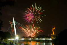 Fireworks at Wichita River Festival, with Keeper of the Plains statue by Blackbear Bosin. Photo by Charles Ford.