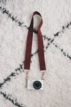 i read that the immediate sign of a non-photographer aka dork is using the camera strap that the camera comes with. well i don't want to look like a dork. so i made myself one. but the best news ab...