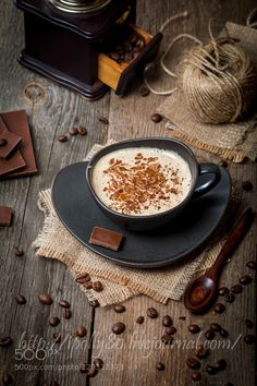 Pic: Cup of coffee with coffee beans and chocolate