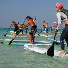 106 Days of Summer, Day 83: Grab a board and try your hand at stand–up paddleboarding on the crystal clear Gulf waters in Destin, Florida. This SUP event features 1–, 3–, and 6–mile race options, with a cash prize awarded to winners. - Coastal Living
