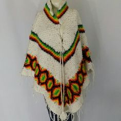 Vintage Boho Knit 60s 70s Hippie Fringe Poncho Super cool vintage 1960s/1970s hippie bohemian, possibly Mexican/South American, knit white and multicolor poncho. So on trend! Classic large poncho shape with fringe edges, a lace-up front, and tassels at neckline. Beautiful pattern. Feels like a wool blend. Handmade. Rare! Great vintage condition; just some average overall wear, but no major flaws. No trades, no PP. Vintage Sweaters Shrugs & Ponchos