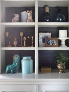 LOVE THE COLORED GRASS CLOTH ON BACK....Eclectic Bookshelf Styling - A Formal Dining Room That's Not Fussy on HGTV