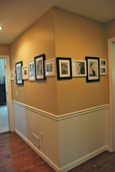 Hallway picture display.  Love how they railroad the display with alternating black/white frames!