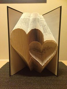 Book folding pattern for 2 Hearts ~ Love ~ Romance ~ Anniversary ~ Wedding +FREE tutorial This pattern enables the folder to create the pattern pictured in to a book. Its not as complicated as it looks! the res. Folded Book Art, Paper Book, Paper Art, Paper Crafts, Cut Paper, Paper Clay, Book Folding Patterns Free, Origami, Old Book Crafts