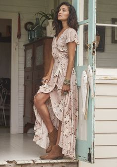 An ode to Summer days...   This gorgeous Wrap Maxi Dress has short light frilled sleeves and an extra special gather insert of extra fabric in the back of the skirt (perfect for twirling). Made from the softest rayon, it has a leg-lovin' split (for showing off your favourite boots).  Pair it with your gypsy gems and sense of adventure. xx Auguste The Label    Our muse Natwears a size 8 and is 170cm tall