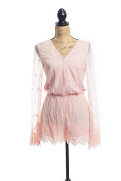 Channel your inner Molly Ringwald with our Pretty In Pink romper. This longsleeve romper is fully lined with sheer arms and lace detailing that lines the arms and shorts. A front clasp and cinched elastic waist fits the curves of your body to flaunt a beautifully feminine look.