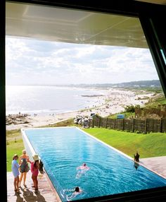 The cantilevered lap pool at Playa Vik juts swimmers off the deck, 32 feet above beachfront that surrounds this contemporary art-filled hotel. At night, the black granite tiles feature a fiberoptic map of the southern hemisphere's night sky.