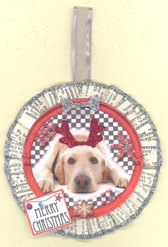 """Yellow Labrador. Measures approx. 3"""" in diameter without the ribbon hanger which is about 1.5"""". The back side is a painted wooden circle that is signed and dated by the artist. The rosette is folded by hand and is made from papers from a 1932 French Dictionary, edges are glittered with ArtGlitter. Hang on a wreath, package, garland, door, tree or light. A perfect gift for you or a dog lover in your life. Convo me if you want different dog breed, it may be possible to custom order one from…"""
