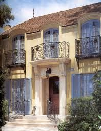 Wrought-iron faux balcony and love the color for shutters