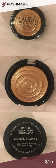 Laura Geller Gilded Honey Baked Gelato Illuminator Effervescent caramel honey Only used about once or twice. Amazing product but just too dark for my skin. :( Swirl pattern still entirely intact. No box.   Illuminate your natural beauty! This innovative hybrid texture applies like a sheer powder but feels like a cream, creating a translucent wash of luminous color that can be swept all over the face for a lit-from-within glow. A fresh 3-D design captures the look of your favorite Italian…