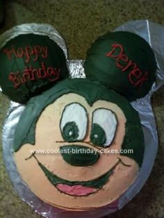 Homemade Mickey Mouse Cake: I made this Mickey Mouse Cake for my son's first birthday since he loves Mickey, who doesn't? I used a round pan for the face and ball cake pans for the