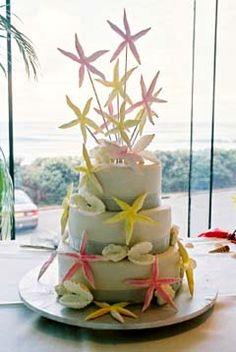Three tier beach sea shell cake decorated with yellow, pink and white star fish and seashells.... Wedding ideas for brides, grooms, parents & planners ... https://itunes.apple.com/us/app/the-gold-wedding-planner/id498112599?ls=1=8 … plus how to organise an entire wedding, without overspending ♥ The Gold Wedding Planner iPhone App ♥