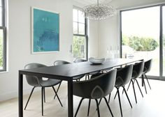 Dining Room: Dark Contemporary Dining Chairs. modern dining chair. dark molded chair. black rectangular dining table. blue wall art. LED chandelier. wood flooring.