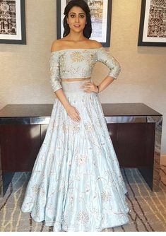 Shreya Saran in a matching crop top and lehenga skirt