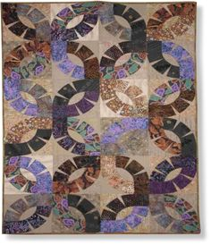 'Matrimony' quilt pattern by Aardvark Quilts.  A contemporary take on a Double Wedding Ring, created with templates and applique.