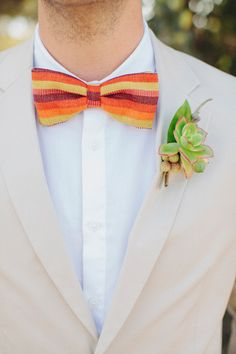 striped bow tie! photo by Dave Richards http://ruffledblog.com/southwestern-san-clemente-wedding #bowtie #groom