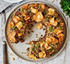 The perfect vegetarian Christmas or Sunday lunch centrepiece - a low-calorie nut loaf packed with grains, root vegetables, mixed mushrooms, herbs and spice