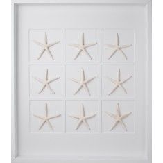 large white starfish wall art in a white shadowbox frame