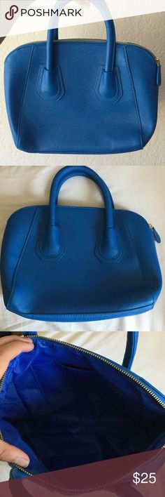 Medium Sized Lancôme Blue Purse Never used before and in great condition. A gorgeous deep blue colored purse with a shiny gold zipper. Inside the purse is a small pouch a wallet or small phone. Sturdy thick purse handles and sturdy purse in general. Lancome Bags Mini Bags