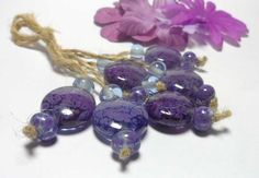 Hey, I found this really awesome Etsy listing at https://www.etsy.com/listing/128050397/lampworkglass-bead-handmade-purple