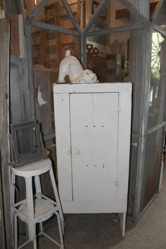 Small white primitive cabinet