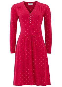 Red V-neck day dress with diamond print in 100% organic cotton. Long sleeve diamond print day dress with panelled waist and shell buttons. Gathered over bust. Length 100cm.