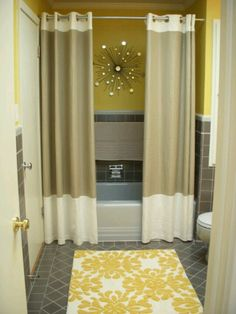 Two shower curtains, love this idea!  Looks great
