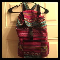 Hand made Peruvian backpack Handmade Peruvian backpack. Beautiful mix of colors, with a front zipper pocket and drawstring/clasp closure. I got this as a gift and never use it. Perfect for festivals! Handmade from Peru Bags Backpacks