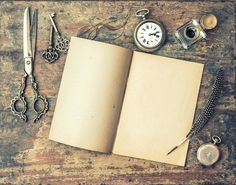 Open book and vintage writing tools by LiliGraphie on Creative Market