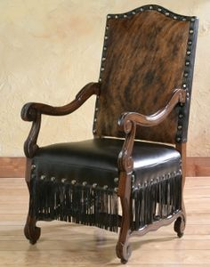 Cabana Fringe Arm Chair Western Accent Chairs - A full leather fringe encircles the seat on this unique western arm chair. Large nail heads accent the hair on hide back and rich dark brown leather seat. Cowhide Decor, Cowhide Furniture, Cowhide Chair, Leather Chair With Ottoman, Western Furniture, Leather Dining Chairs, Home Decor Furniture, Unique Furniture, Rustic Furniture