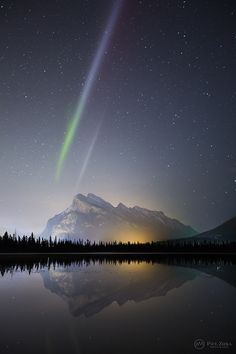 "Wednesday, May 20, 2015: Astrophotographer Paul Zizka sent in a photo of an auroral display over Vermilion Lakes, Banff National Park, located in the Canadian Rockies, taken May 10, 2015. On his Facebook profile page, he described it as: ""A rather unusual, bicolored aurora structure (proton arc?) that sat very still on top of Mount Rundle for a good 20 minutes just an hour ago.""%u2014 Tom Chao"