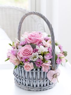 Baby Girl Basket ArrangementFeaturing a pink spray carnation, a pink alstroemeria, 2 pink freesias, 2 pink large-headed roses, a pink spray chrysanthemum and a white lisianthus with eucalyptus presented in a round woven basket with pink heart trim. Beautiful Rose Flowers, Silk Flowers, Spring Flowers, Basket Flower Arrangements, Floral Arrangements, Deco Floral, Arte Floral, Flower Basket, Flower Boxes